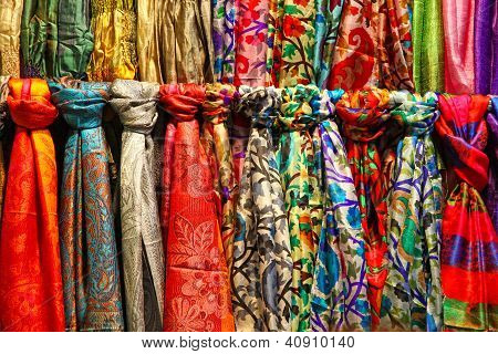Colourful Silk Scarfs Hanging At A Market Stall