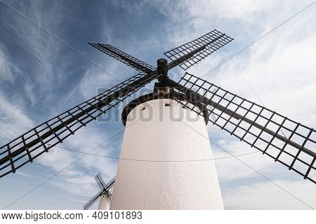 Old White Windmill Against Blue Sky In Campo De Criptana, Castile La Mancha, Spain.