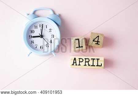 April 14th. Wooden Cubes With Date Of 14 April On Old Pink Background.