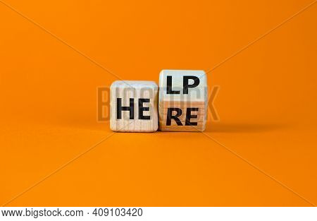Help Is Here Symbol. Turned Cubes And Changed The Word Help To Here. Beautiful Orange Background, Co