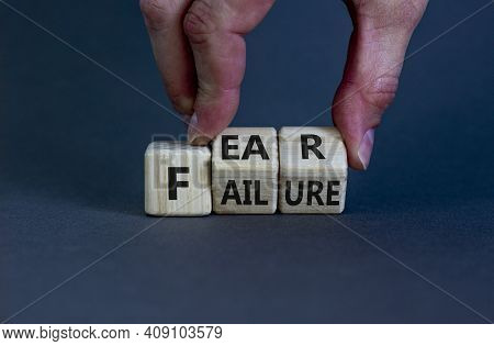 Fear Of Failure Symbol. Businessman Turns Wooden Cubes And Changes The Word 'failure' To 'fear'. Bea