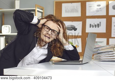 Funny Young Weird Stressed Man Accountant Sitting At Laptop Touching Head Feeling Burnout