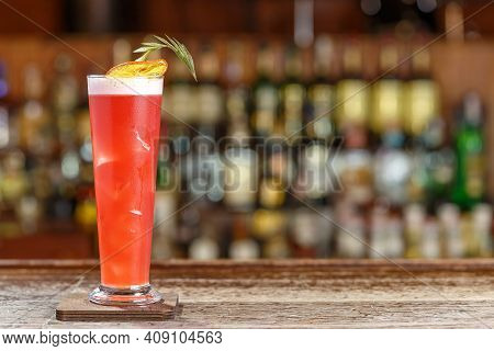 Cocktail Singapore Sling On The Background Of The Bar In The Nightclub. Photo For The Bar Menu. Spac