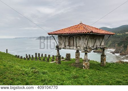 Horreo, A Traditional Asturian Granary Built In Wood And Stone At The Cliffs Overlooking Cantabrian