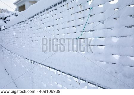 A Snow-covered Metal Mesh Slave - Abstract Background.