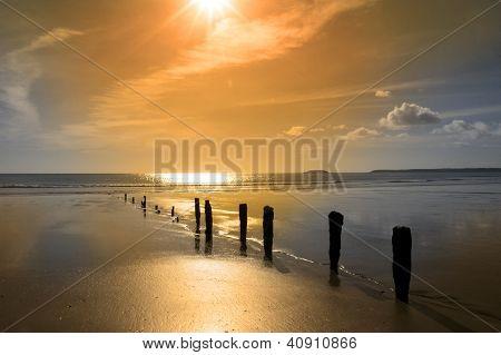 Golden Sunrise Over The Beach Breakers
