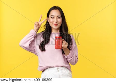 People Emotions, Lifestyle Leisure And Beauty Concept. Cute Happy, Pretty Asian Girl Smiling And Sho