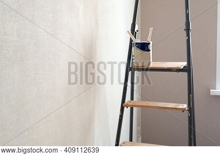 Paint  Can With Brushes On Stepladder. Home Renovation Concept