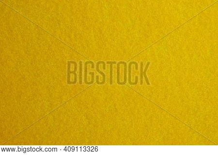 High Resolution Close Up Of Bright Yellow Felt Fabric.