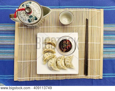 Chinese Fried Dumplings Called Jiaozi With Sauce Made Of Vinegar, Garlic, And Soy Sauce. It's Served