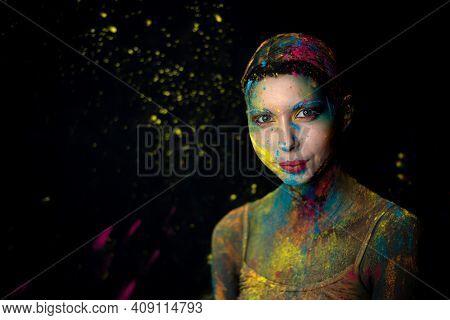 Portrait Of Beauty Model With Holi Colorful Powder Art Make On Black Background.