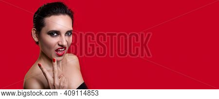 Horizontal Banner. Woman With Bright Makeup And Emotional Face Posing On Red Studio Background And S