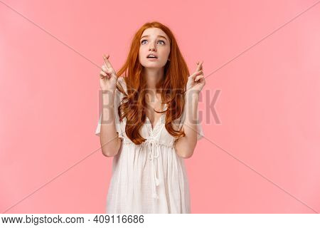Hopeful And Excited, Dreamy Cute Redhead Girl Making Wish On Shooting Star, Looking Up Amused And Ov