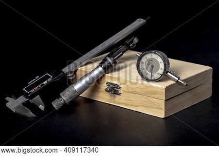 Wooden Box With Measuring Tools. Accessories For Mechanics And Engineers.