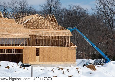 Winter Construction Of A Plywood House Roof Framework