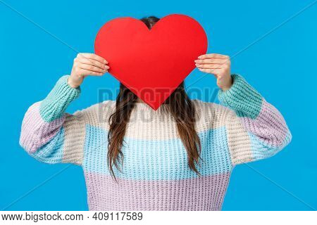 Be My Valentine. Cute Romantic Shy Girl In Sweater Hiding Head Behind Red Big Heart Sign, Express Lo