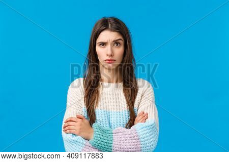 Skeptical, Annoyed And Displeased Young Woman Hearing Something Stupid, Nonsense, Raise Eyebrow And