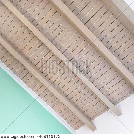 Wooden Ceiling With Exposed Beams. Interior Wooden Roof With Exposed Beams. Bottom View.