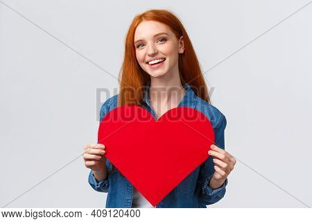 Valentines Day, Romance And Teenagers Concept. Lovely And Cute Redhead Girlfriend Asking Wanna Go Pr