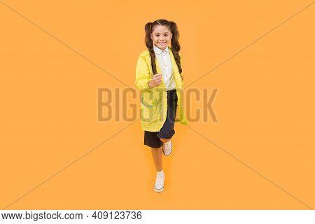 Schoolgirl Wear Raincoat. Schoolgirl Wear Water Resistant Clothes. Rainy Day. Cute Schoolgirl Feel P
