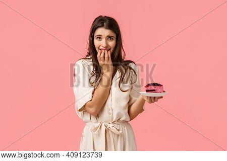 Temptation, Diet And Desserts Concept. Alluring Young Feminine Sporty Brunette Girl In Dress, Trying