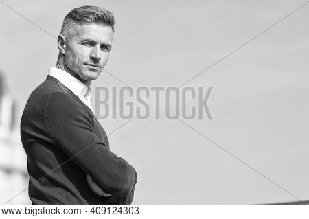 Adult Man With Crossed Hands. Full Of Confidence. Businessman In Informal Setting. Male Beauty Stand