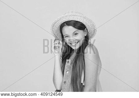 Full Of Joy. Happy Childhood. Cheerful Little Girl Wear Straw Hat. Beach Fashion For Kids. Small Chi