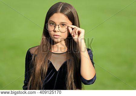 Cute Little Girl With Long Hair In Fashion Black Wear Fix Corrective Glasses With Beauty Look Green