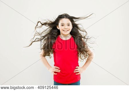 Kid Cute Face With Adorable Curly Hairstyle. Little Girl Grow Long Hair. Teen Fashion Model. Discove