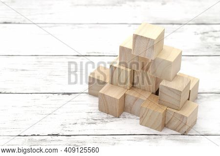 Natural Wooden Toy Blocks On White Wooden Table