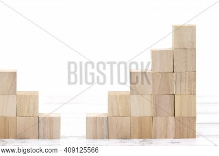 Stairs Of Wooden Toy Blocks On White Table