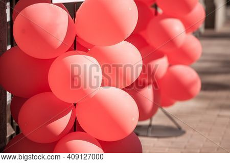 Bunch Of Many Inflatable Balloons, Red Rubber Ballons, Inflated, On Display As A Photo In Outdoor, D