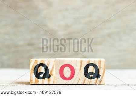 Alphabet Letter Block In Word Qoq (abbreviation Of Quarter On Quarter) On Wood Background