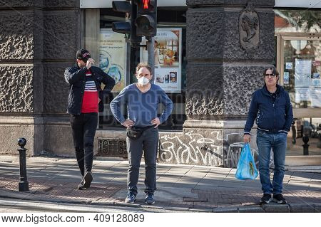 Belgrade, Serbia - October 10, 2020: Three Men, Middle Aged Looking At A Street Traffic On A Bouleva