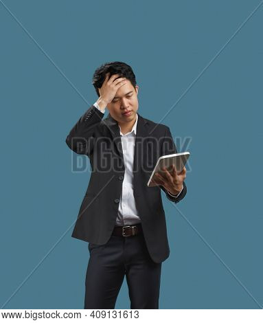 Declining Sales Growth , Young Business Man Reading Document Of Decline In Sales After Covid-19 Pand