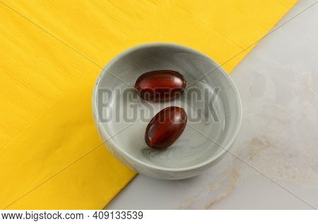 Cola Flavored Fizzy Hard Candy Pieces In Bowl With Yellow Napkin On Table