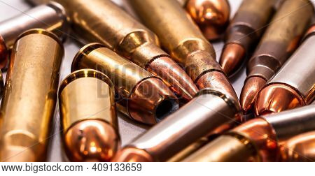 Different Bullets For Handguns And Rifles In 40 Caliber, 9mm And 223 Caliber On A White Background