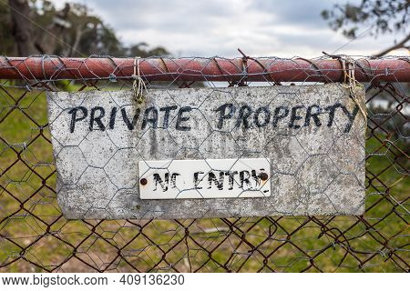 A Weathered Private Propoerty And No Entry Sign Located On An Old Property Gate, South Coast Nsw Aus