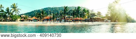 Tropical Beach With Palm Trees And Tropical Plants And Bungalows, Tourist Vacation Panoramic View Of