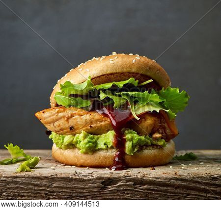 Fresh Tasty Burger On A Black Background. Burger With Beef, Cheese, Bacon And Vegetables. Close-up O