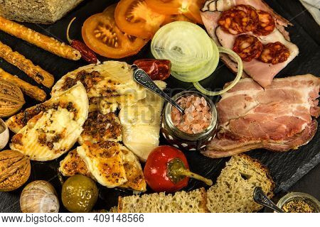 Cheese Plate With Pieces Moldy Cheese. Pickled Camembert Cheese With Peppers And Homemade Bread. Pic