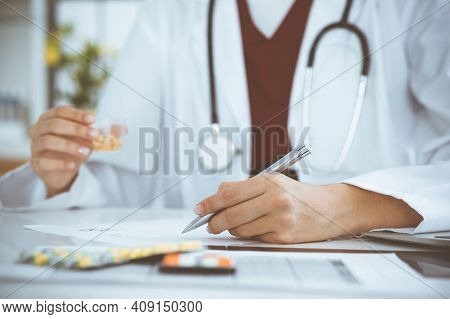 Unknown Woman-doctor Fills Up Prescription Form. Close-up. Panacea And Life Save, Prescribe Treatmen