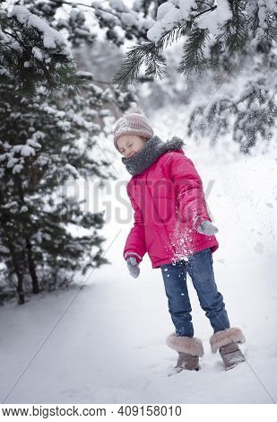 Child In Winter. A Little Girl,  Playing In The Winter Outside.