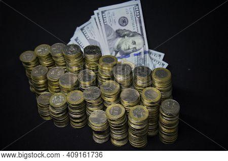 Coins on a dark background. Coins Kazakhstan tenge on a dark background. Kazakh money. Coins of teng