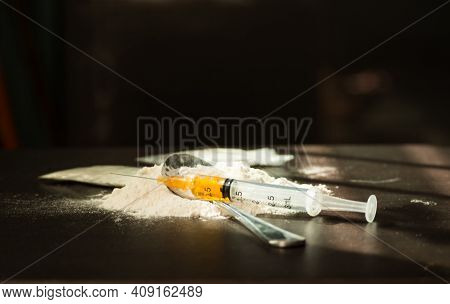 Heroin, Injection, Old Spoon,injection Needle On Dark Wooden Black Background. Heroin Is Hard Drugs.