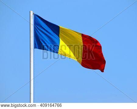 Romanian Flag On The Flagpole Under Blue Sky