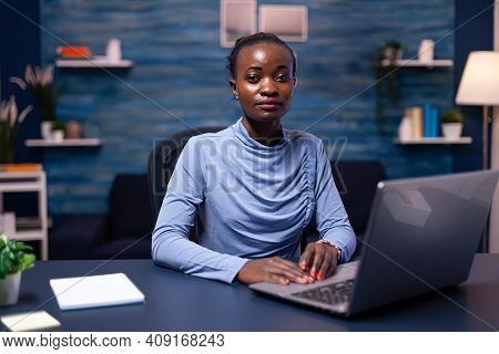 African Businesswoman Holding Hands On Keyboard While Working From Home Late At Night. Black Entrepr