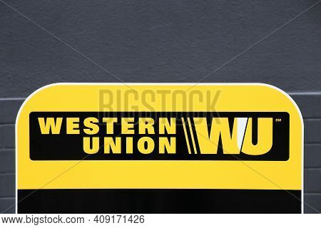 Tarare, France- June 27, 2020: Western Union Sign And Point. The Western Union Company Is An America