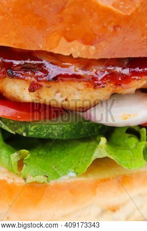 The Burger Is Juicy. Hamburger With A Juicy Cutlet. Sandwich With Cutlet And Onion. Burger With Onio