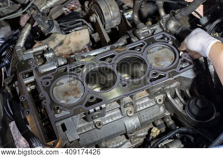 Auto Mechanic Working In Garage. Repair Service. The Connecting Rod, Piston And Cylinder Block In A